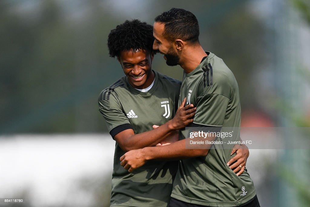 Juan Cuadrado and Medhi Benatia during a Juventus Training Session at Juventus Center Vinovo on September 26, 2017 in Vinovo, Italy.