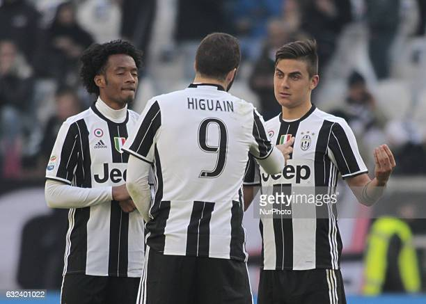 Juan Cuadrado Gonzalo Higuain and Paulo Dybala during Serie A match between Juventus v Lazio in Turin on January 22 2017