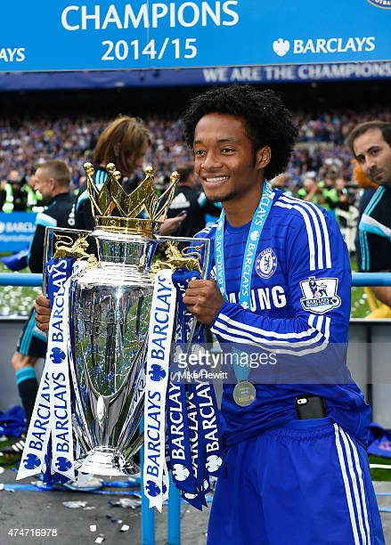 Juan Cuadrado of Chelsea celebrates with the trophy after the Barclays Premier League match between Chelsea and Sunderland at Stamford Bridge on May...