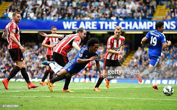 Juan Cuadrado of Chelsea is brought down by John O'Shea of Sunderland during the Barclays Premier League match between Chelsea and Sunderland at...