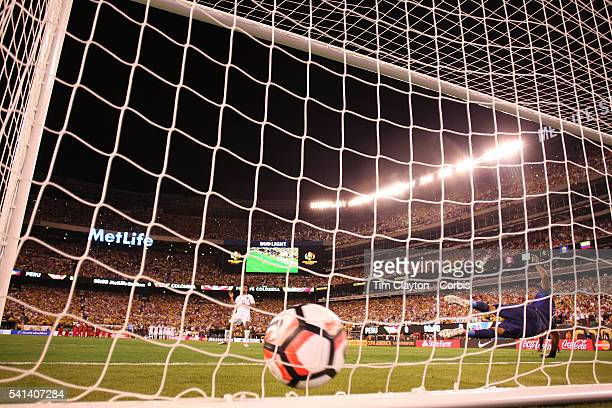 Juan Cuadrado of Colombia beats Pedro Gallese of Peru from the penalty spot during the penalty shoot out during the Colombia Vs Peru Quarterfinal...