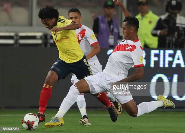 Juan Cuadrado of Colombia fights for the ball with Renato Tapia of Peru during a match between Peru and Colombia as part of FIFA 2018 World Cup...