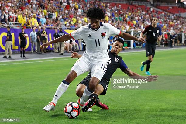 Juan Cuadrado of Colombia is tackled by Michael Orozco of United States during the first half of the 2016 Copa America Centenario third place match...