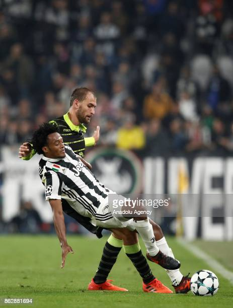 Juan Cuadrado of FC Juventus in action against Marcos Acuna of Sporting SP during the UEFA Champions League group D football match between FC...