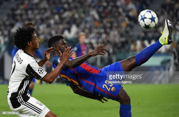 Juan Cuadrado of FC Juventus in action against Samuel Umtiti of FC Barcelona during the UEFA Champions League Round of 4 first leg match between FC...