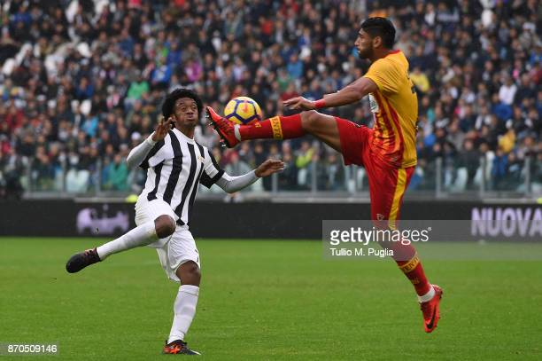 Juan Cuadrado of Juventus and Achraf Lazaar of Benevento compete for the ball during the Serie A match between Juventus and Benevento Calcio on...