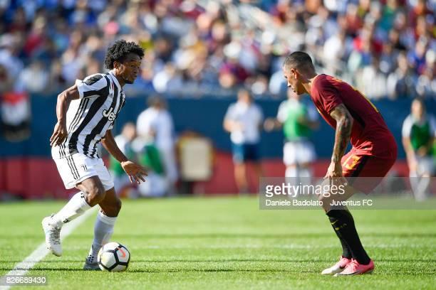 Juan Cuadrado of Juventus and Aleksandar Kolarov in action during the International Champions Cup 2017 match between AS Roma and Juventus at Gillette...