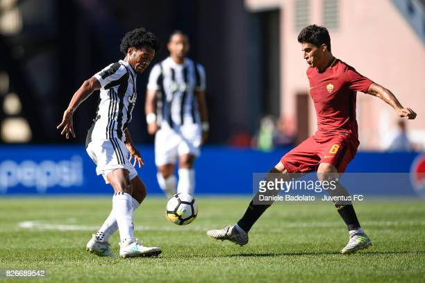 Juan Cuadrado of Juventus and Diego Perotti of Roma in action during the International Champions Cup 2017 match between AS Roma and Juventus at...