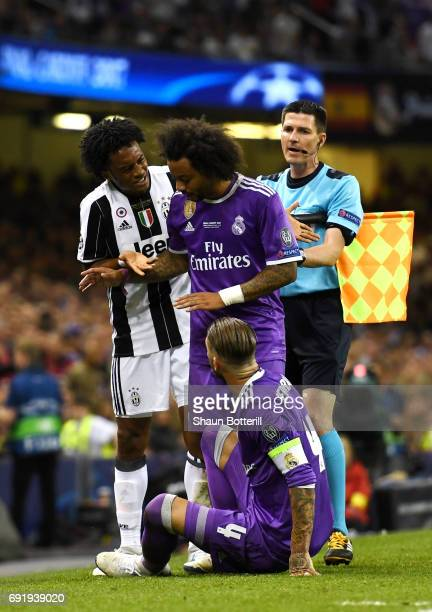 Juan Cuadrado of Juventus and Marcelo of Real Madrid exchange words as Sergio Ramos of Real Madrid looks on during the UEFA Champions League Final...