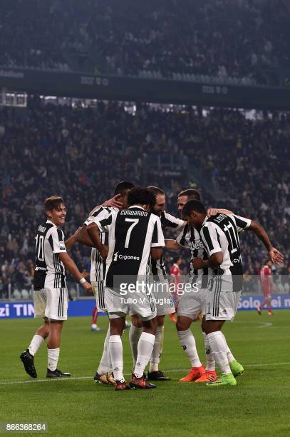 Juan Cuadrado of Juventus celebrates after scoring his team's fourth goal during the Serie A match between Juventus and Spal on October 25 2017 in...