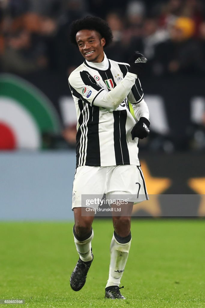 Juan Cuadrado of Juventus celebrates scoring the first goal during the Serie A match between Juventus FC and FC Internazionale at Juventus Stadium on February 5, 2017 in Turin, Italy.