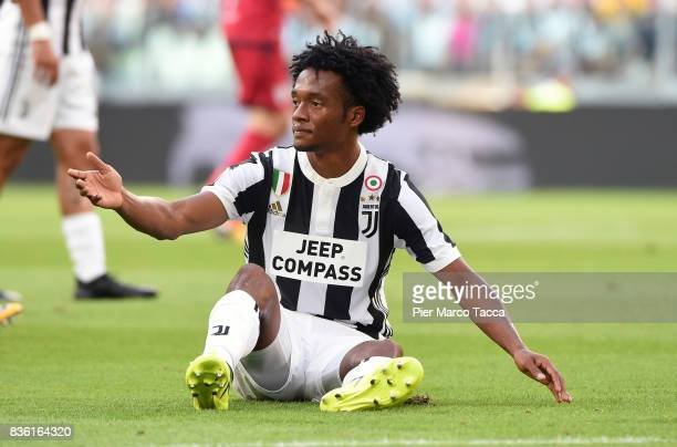 Juan Cuadrado of Juventus fall down during the Serie A match between Juventus and Cagliari Calcio at Allianz Stadium on August 19 2017 in Turin Italy