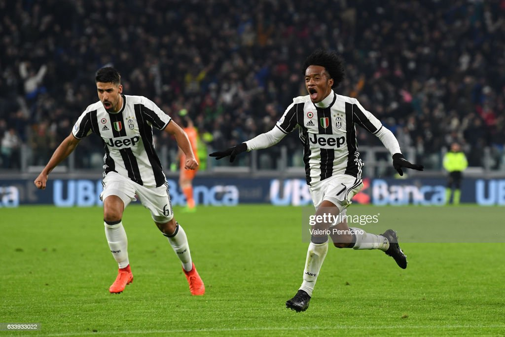 Juan Cuadrado (L) of Juventus FC celebrates after scoring the opening goal with team mates Sami Khedira during the Serie A match between Juventus FC and FC Internazionale at Juventus Stadium on February 5, 2017 in Turin, Italy.
