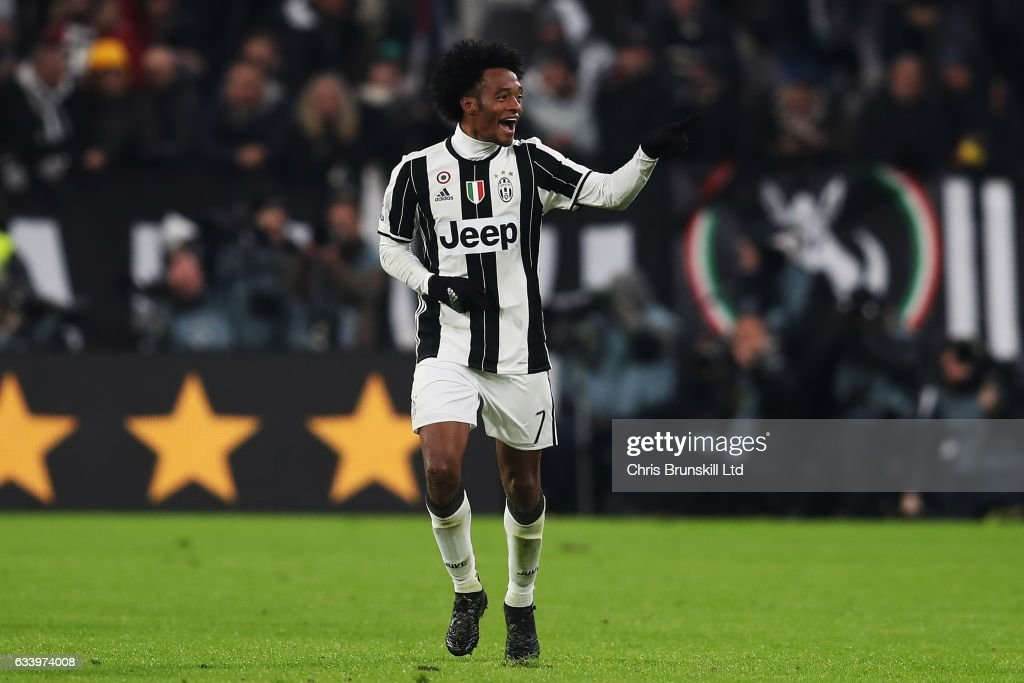 Juan Cuadrado of Juventus FC celebrates scoring the opening goal during the Serie A match between Juventus FC and FC Internazionale at Juventus Stadium on February 5, 2017 in Turin, Italy.