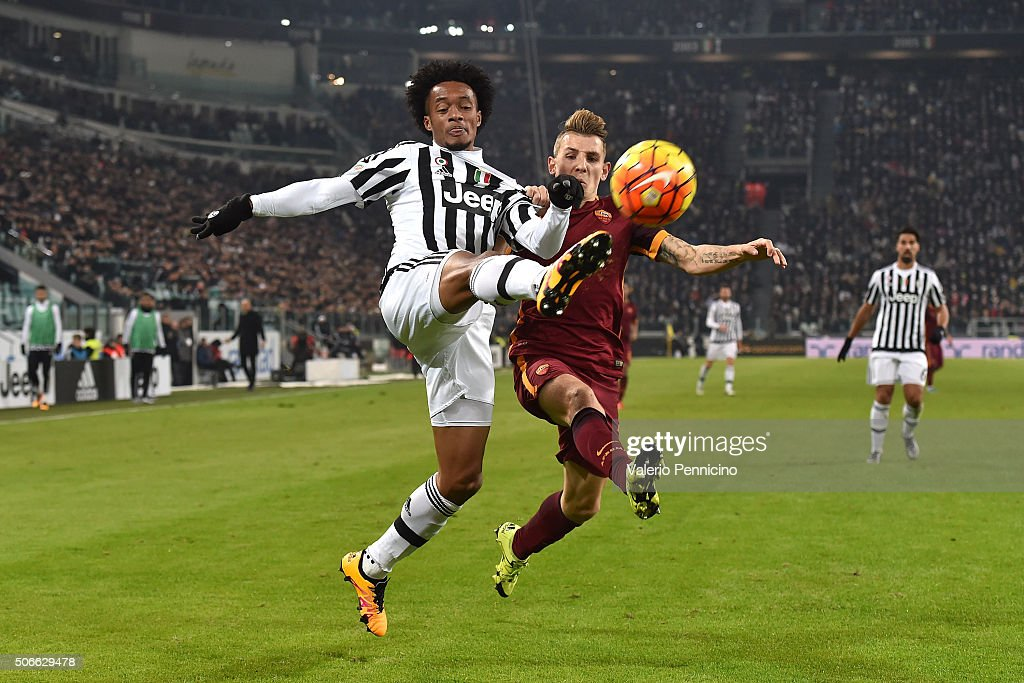 Juan Cuadrado (L) of Juventus FC competes with <a gi-track='captionPersonalityLinkClicked' href=/galleries/search?phrase=Lucas+Digne&family=editorial&specificpeople=5805298 ng-click='$event.stopPropagation()'>Lucas Digne</a> of AS Roma during the Serie A match between Juventus FC and AS Roma at Juventus Arena on January 24, 2016 in Turin, Italy.