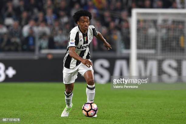 Juan Cuadrado of Juventus FC in action during the Serie A match between Juventus FC and AC ChievoVerona at Juventus Stadium on April 8 2017 in Turin...