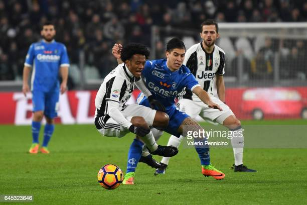 Juan Cuadrado of Juventus FC is challenged by Jose Mauri of Empoli FC during the Serie A match between Juventus FC and Empoli FC at Juventus Stadium...