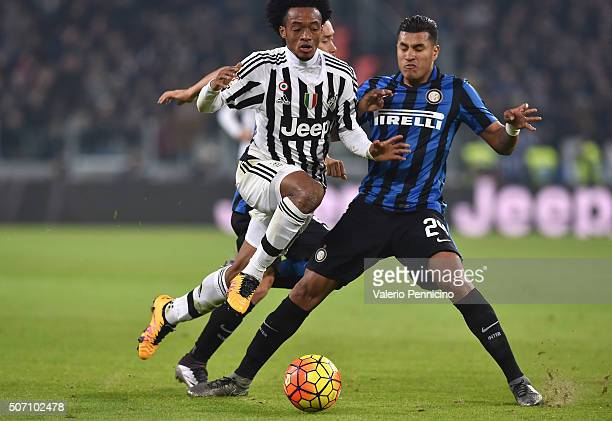 Juan Cuadrado of Juventus FC is tackled by Jeison Murillo of FC Internazionale Milano during the TIM Cup match between Juventus FC and FC...