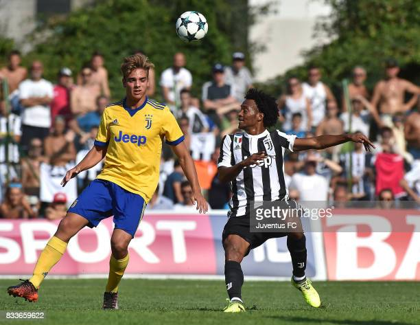 Juan Cuadrado of Juventus fights for the ball during the preseason friendly match between Juventus A and Juventus B on August 17 2017 in Villar...