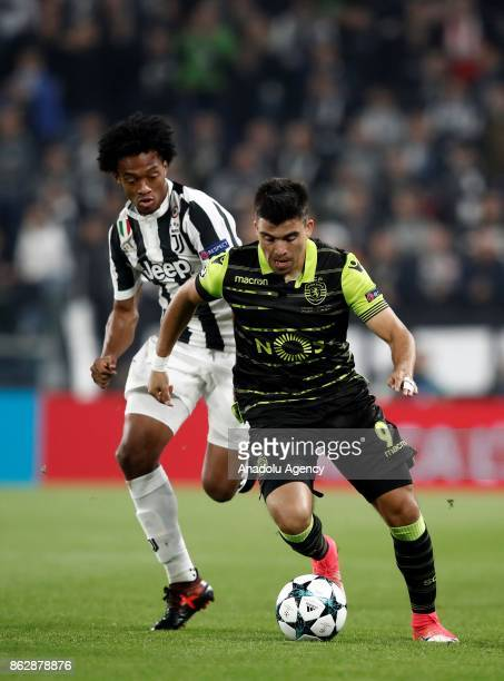Juan Cuadrado of Juventus in action against Marcos Acuna of Sporting CP during the UEFA Champions League group D football match between FC Juventus...