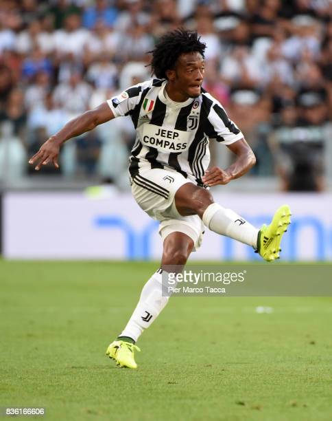 Juan Cuadrado of Juventus in action during the Serie A match between Juventus and Cagliari Calcio at Allianz Stadium on August 19 2017 in Turin Italy