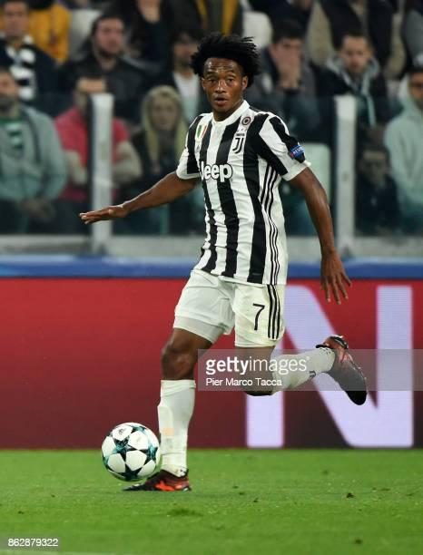 Juan Cuadrado of Juventus in action during the UEFA Champions League group D match between Juventus and Sporting CP at Juventus Stadium on October 18...