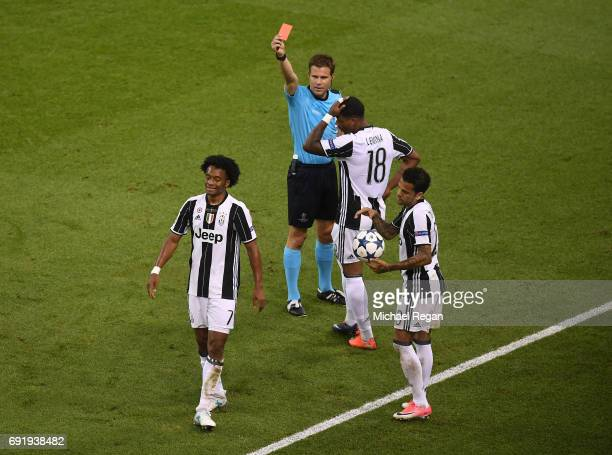 Juan Cuadrado of Juventus is shown a red card by referee Felix Brych during the UEFA Champions League Final between Juventus and Real Madrid at...