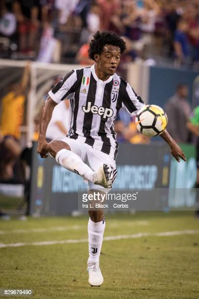 Juan Cuadrado of Juventus kicks the ball to keep control during the International Champions Cup match between FC Barcelona and Juventus at the...
