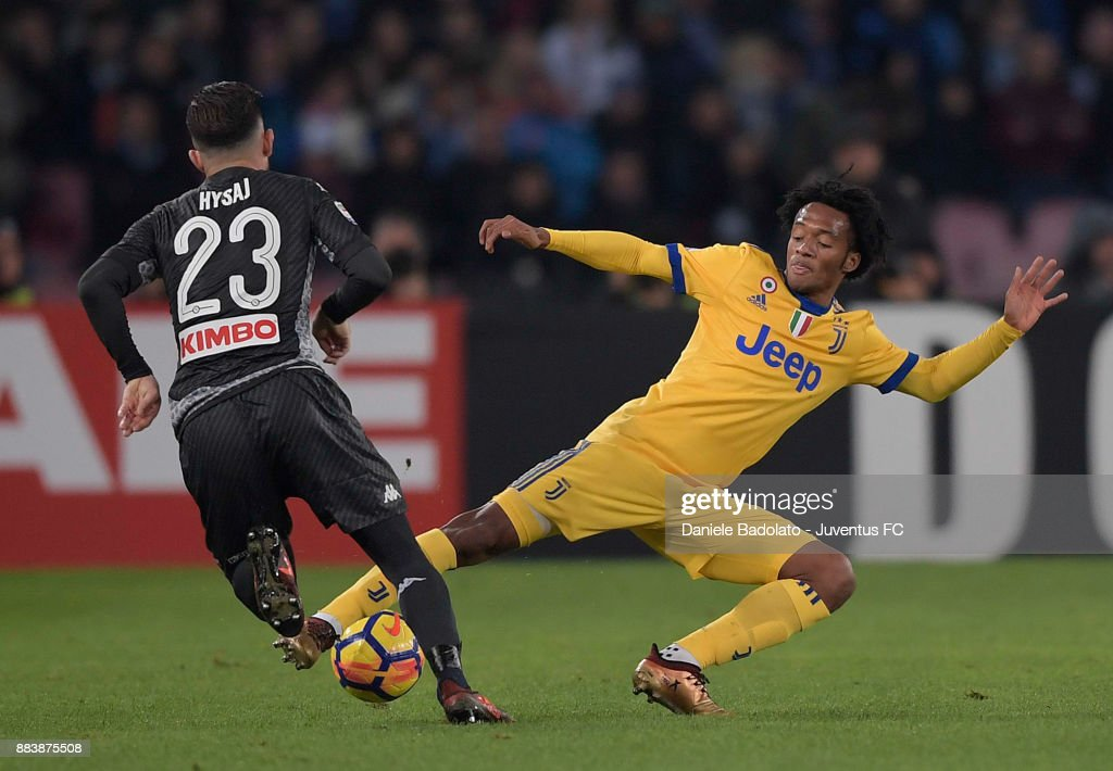 Juan Cuadrado of Juventus makes a tackle during the Serie A match between SSC Napoli and Juventus at Stadio San Paolo on December 1, 2017 in Naples, Italy.