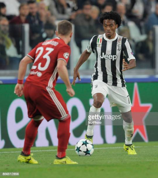 Juan Cuadrado of Juventus player and Leonardo Koutris of Olympiacos player during the Uefa Champions League 20172018 match between FC Juventus and...