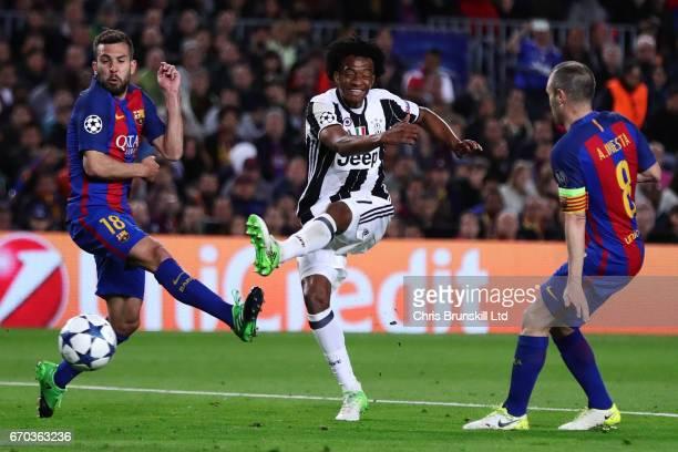 Juan Cuadrado of Juventus shoots past Jordi Alba of FC Barcelona during the UEFA Champions League Quarter Final second leg match between FC Barcelona...
