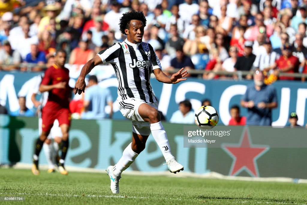 Juan Cuadrado #7 of Juventus takes a shot on goal during the International Champions Cup 2017 match against Roma at Gillette Stadium on July 30, 2017 in Foxboro, Massachusetts.