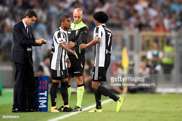 Juan Cuadrado substituted by Douglas Costa during the Italian Supercup match between Juventus and SS Lazio at Stadio Olimpico on August 13 2017 in...