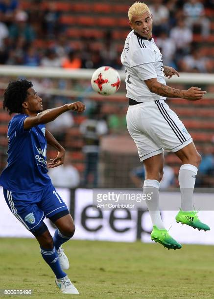 Juan Cuadrado vies for the ball with Edwin Cardona during a friendly match organized by the Juan Cuadrado foundation between the friends of Colombian...