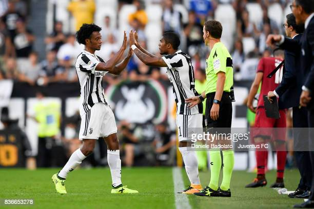 Juan Cuadrato substituted by Douglas Costa during the Serie A match between Juventus and Cagliari Calcio at Allianz Stadium on August 19 2017 in...