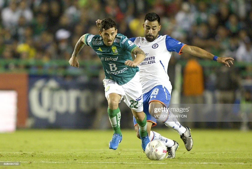 Juan Cuevas of Leon vies for the ball with Ariel Rojas of Cruz Azul during their Mexican Clausura tournament football match at the Nou Camp stadium...
