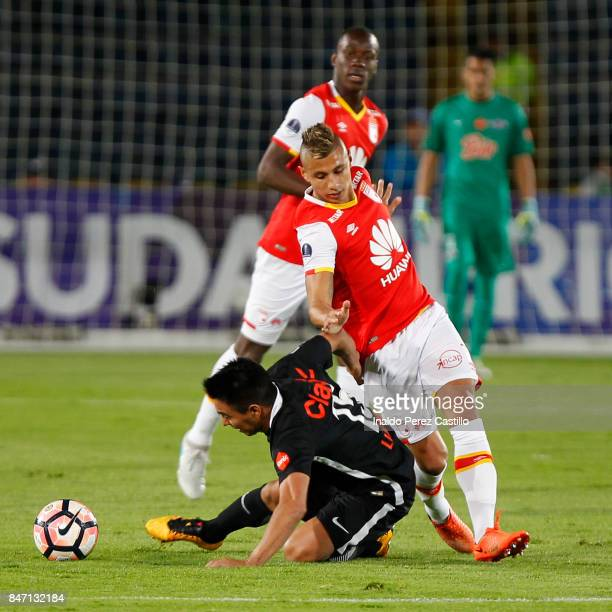 Juan Daniel Roa of Santa Fe and Angel Cardozo of Libertad compete for the ball during a second leg match between Independiente Santa Fe and Libertad...