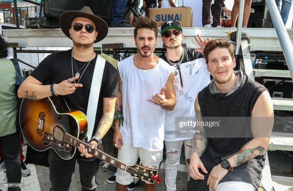 Juan David M. Castano, Juan David Huertas Clavijo, Pablo Mejia Bermudez and David Escobar Gallego of Piso 21 backstage during the iHeartLatino TU94.9FM Calle Ocho festival on March 12, 2017 in Miami, Florida.