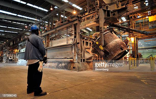 Juan Davis a primary aluminum plant metal handler for Alcoa Inc uses a remote control to pour molten aluminum into a cast house furnace at the...