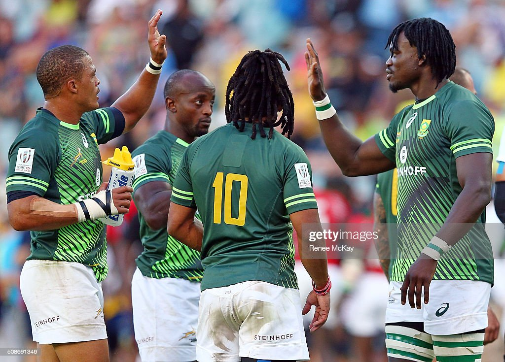 Juan de Jongh and Tim Agaba of South Africa celebrate their teams win at the day 1 match between South Africa and Kenya at the HSBC Sydney Sevens at Allianz Stadium on February 06, 2016 in Sydney, Australia.