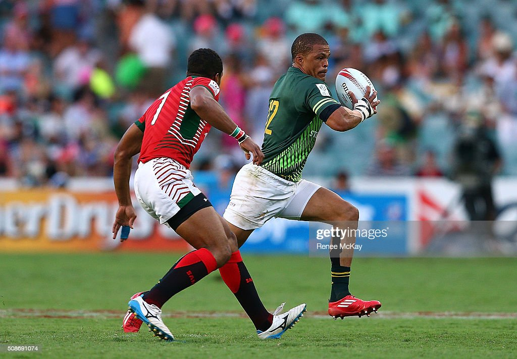 Juan de Jongh of South Africa gets away from Biko Adema of Kenya during the day 1 match between South Africa and Kenya at the HSBC Sydney Sevens at Allianz Stadium on February 06, 2016 in Sydney, Australia.
