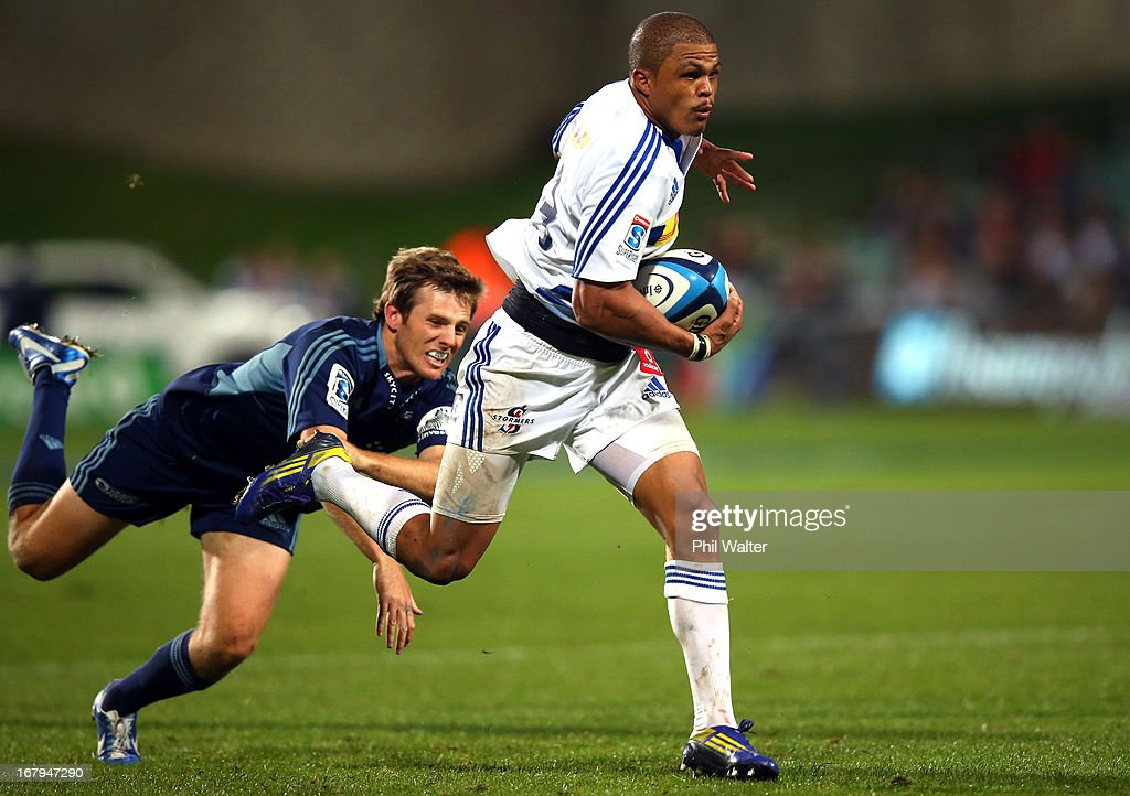 <a gi-track='captionPersonalityLinkClicked' href=/galleries/search?phrase=Juan+De+Jongh&family=editorial&specificpeople=4855250 ng-click='$event.stopPropagation()'>Juan De Jongh</a> of the Stormers is tackled by Chris Noakes of the Blues during the round 12 Super Rugby match between the Blues and the Stormers at North Harbour Stadium on May 3, 2013 in Auckland, New Zealand.