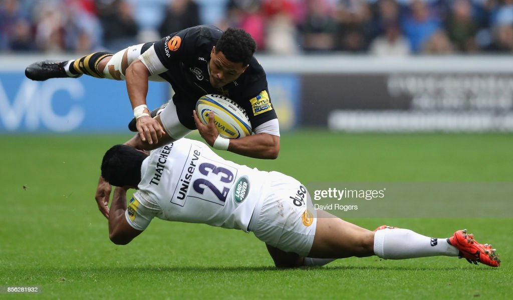 Juan de Jongh of Wasps is tackled by Ben Tapuai during the Aviva Premiership match between Wasps and Bath Rugby at The Ricoh Arena on October 1, 2017 in Coventry, England.