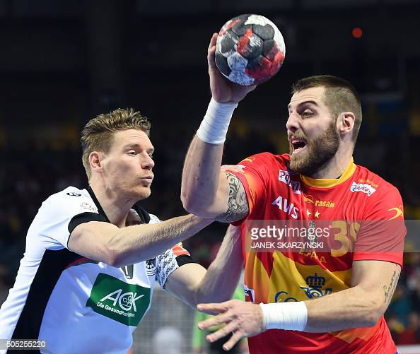 Juan Del Arco of Spain scores a goal against Tobias Reichmann of Germany during their group C match Spain vs Germany of the Men's EHF European...
