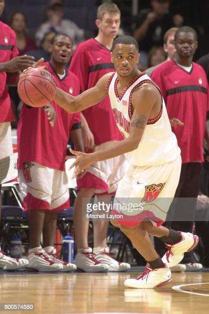 Juan Dixon of the Maryland Terrapins dribbles up court during the BBT College Basketball Classic game against the Princeton Tigers at MCI Center on...