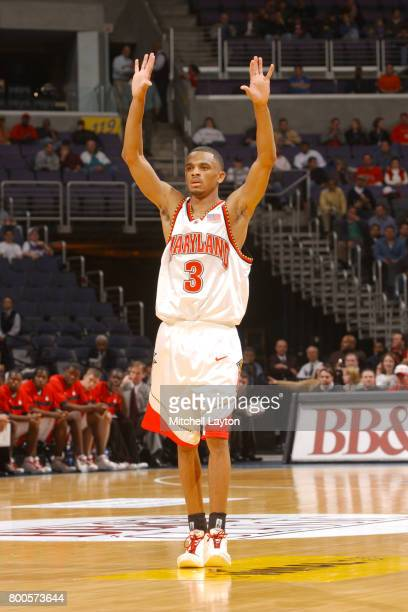 Juan Dixon of the Maryland Terrapins looks on during the BBT College Basketball Classic game against the Princeton Tigers at MCI Center on December 3...