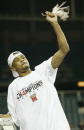 Juan Dixon of the University of Maryland Terrapins celebrates with a piece of the net after winning the men's NCAA National Championship game against...