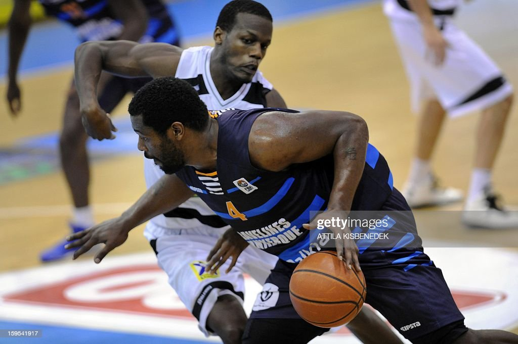 Juan Edwards (R) of French BCM Gravelines Dunkerque fights for the ball with Reshad Ernests Bell (L) of Hungarian KK Szolnoki Olaj on January 15, 2015 during their FIBA EuroChallenge match.