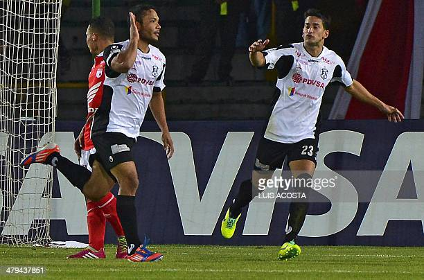 Juan Falcon of Venezuela's Zamora celebrates after scoring against Colombia's Santa Fe during their Libertadores Cup football match at the El Campin...