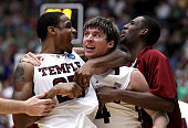 Juan Fernandez celebrates with Lavoy Allen of the Temple Owls after scoring the winning basket to defeat the Penn State Nittany Lions 66 to 64 in the...